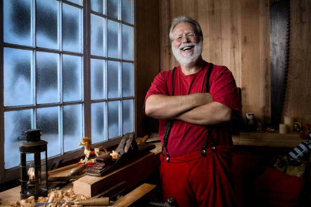 Cheerful Santa Claus Laughing in His Christmas Workshop, Copy Space stock photo