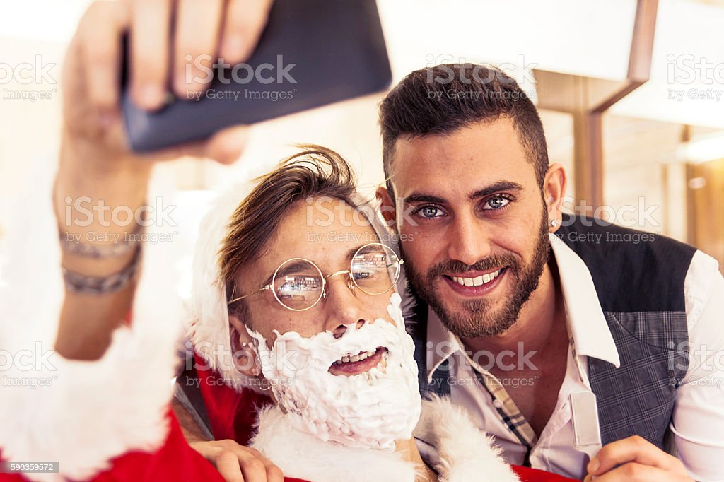 santa claus takes a selfie with your barber royalty-free stock photo