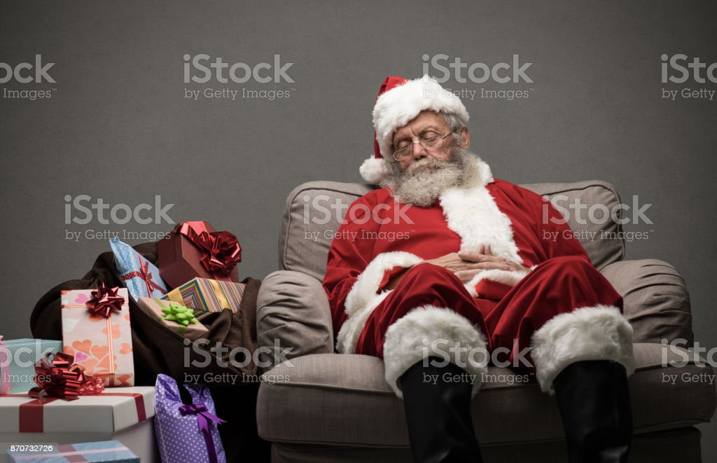 Santa Claus taking a nap stock photo