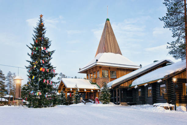 Santa Claus Village with Christmas tree Lapland Santa Claus Office in Santa Village with Christmas tree, Lapland, Finland, on Arctic Circle in winter. People on the background village stock pictures, royalty-free photos & images