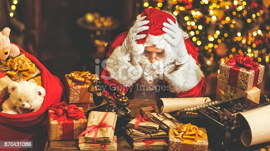 istock Santa Claus was tired under stress 870431086