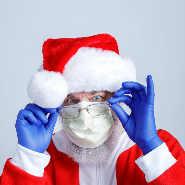 Santa Claus Wearing Covid-19 Face Mask and Gloves stock photo