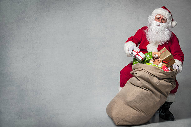 Santa Claus with a bag of presents stock photo