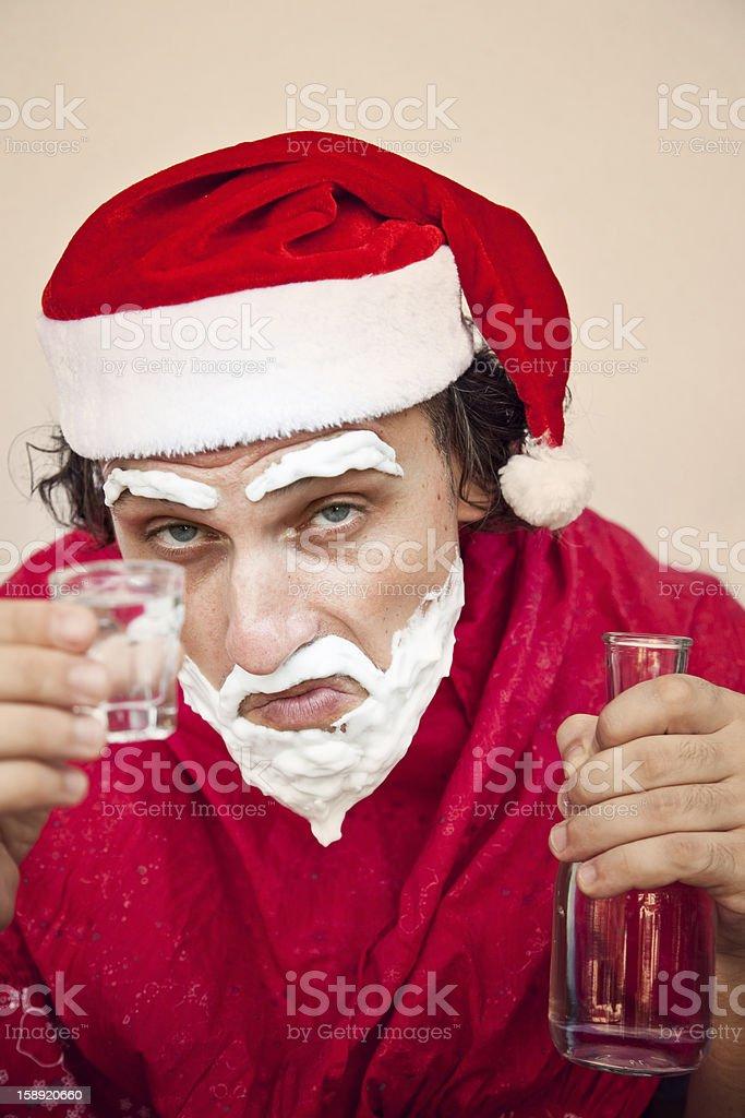 Santa Claus with a beard of shaving cream drink vodka royalty-free stock photo