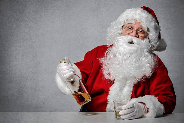 santa claus with a bottle of whisky - drunk stock photos and pictures