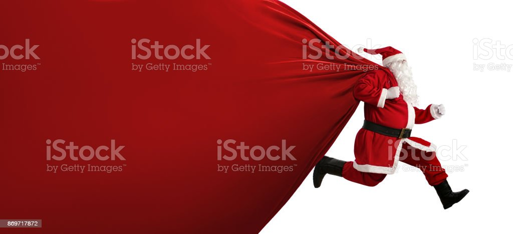 Santa Claus with a huge bag on the run - Foto stock royalty-free di Adulto