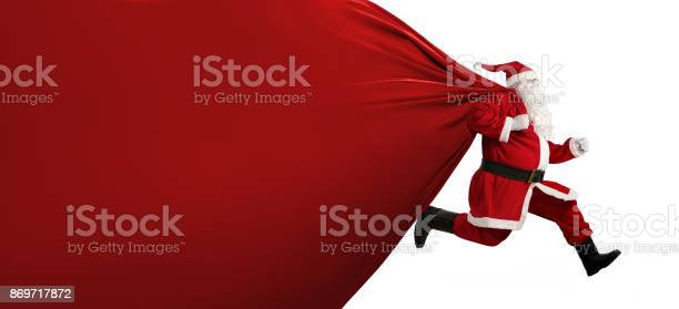 Santa claus with a huge bag on the run picture id869717872?b=1&k=6&m=869717872&s=612x612&h=jyhbrtsq2b1yer7uyytdscweiypqmojqv ms8kmvdjs=
