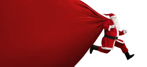 santa claus with a huge bag on the run - christmas stock photos and pictures