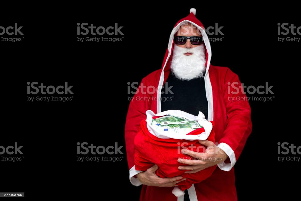 Santa Claus with bag full of money stock photo