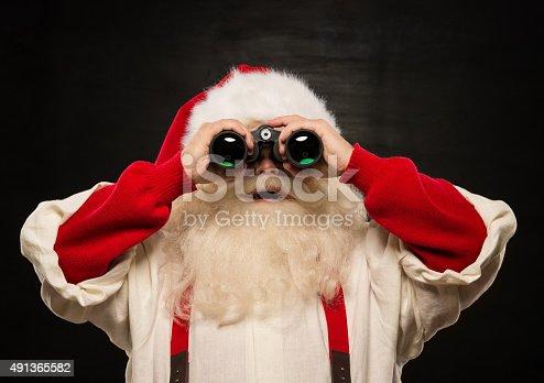 621898406 istock photo Santa Claus with binoculars 491365582
