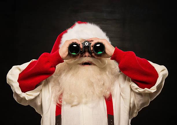 Santa Claus with binoculars stock photo