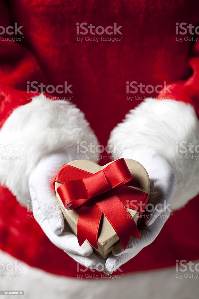 Santa Claus with Christmas present royalty-free stock photo