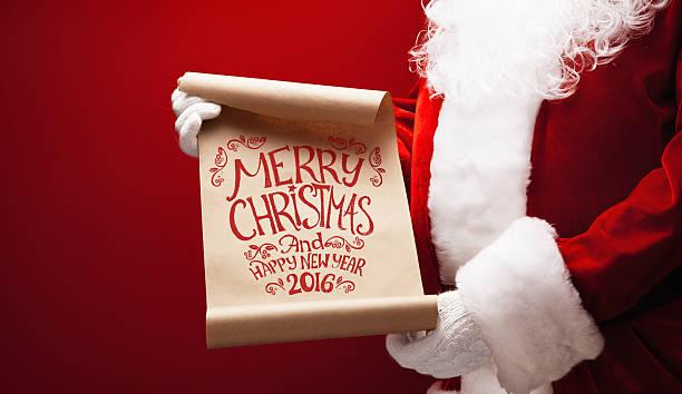 santa claus mit einem glückwunsch - weihnachts wunschliste stock-fotos und bilder