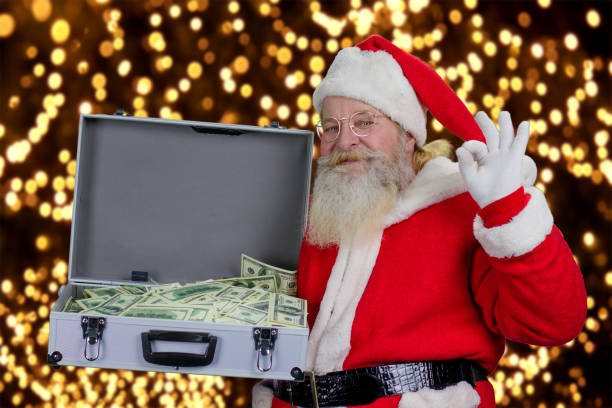 santa claus with full case of dollars. - holiday and invoice family foto e immagini stock