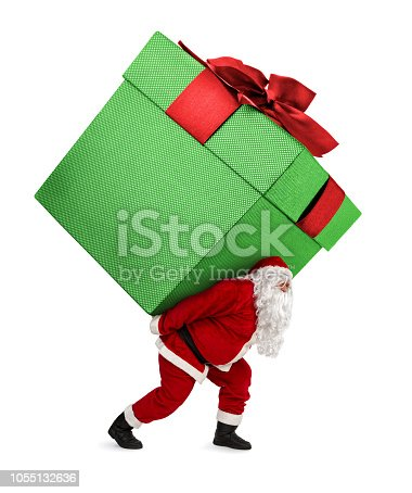 Santa Claus carrying huge christmas gift box isolated on white background