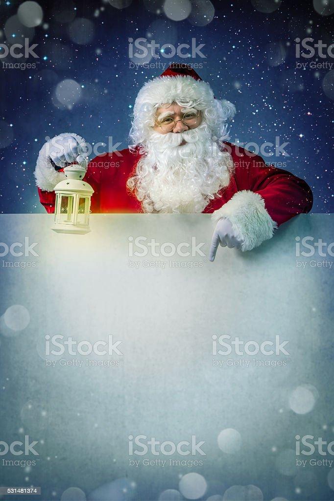 Santa claus with lantern stock photo