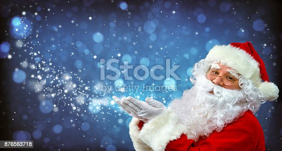 istock Santa Claus with magic light in his hands 876563718