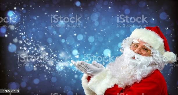 Santa claus with magic light in his hands picture id876563718?b=1&k=6&m=876563718&s=612x612&h= yuunzrm7ebqewpj0ft0ag 63tihtyy zw1w2dcvvam=