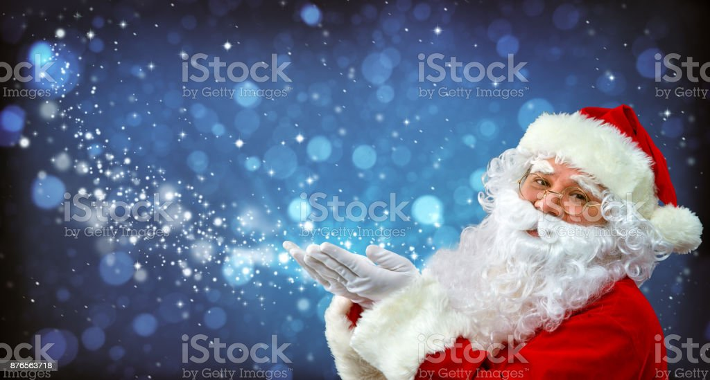 Santa Claus with magic light in his hands - foto stock