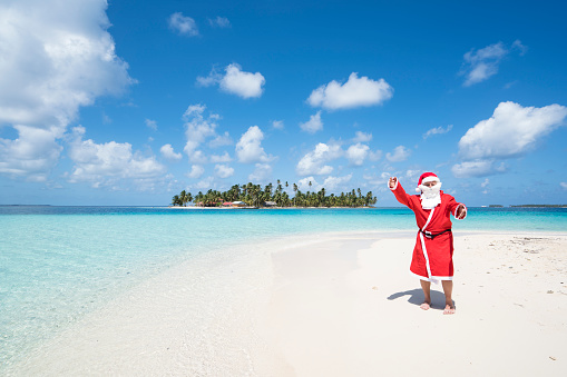 Santa Claus  with open arms on beach  of Isla de Perro Island in Caribbean See, Panama