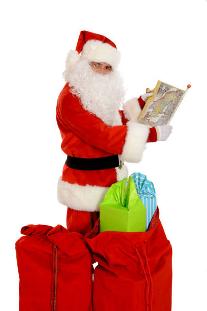 Santa Claus with presents looking at the world map – zdjęcie