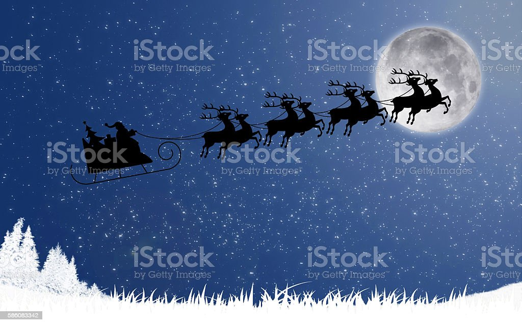 Santa Claus with reindeer sleigh flying against the moon stock photo