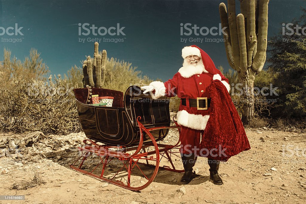 Santa Claus with sleigh in desert stock photo
