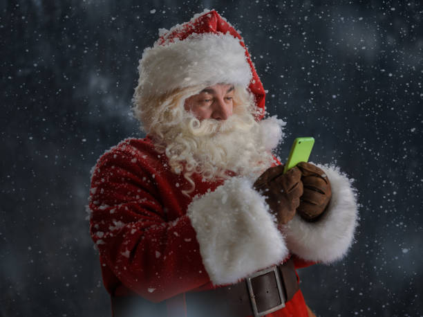 Santa Claus with smartphone stock photo
