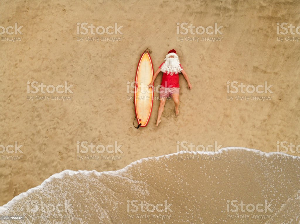 Santa Claus with surf board stock photo