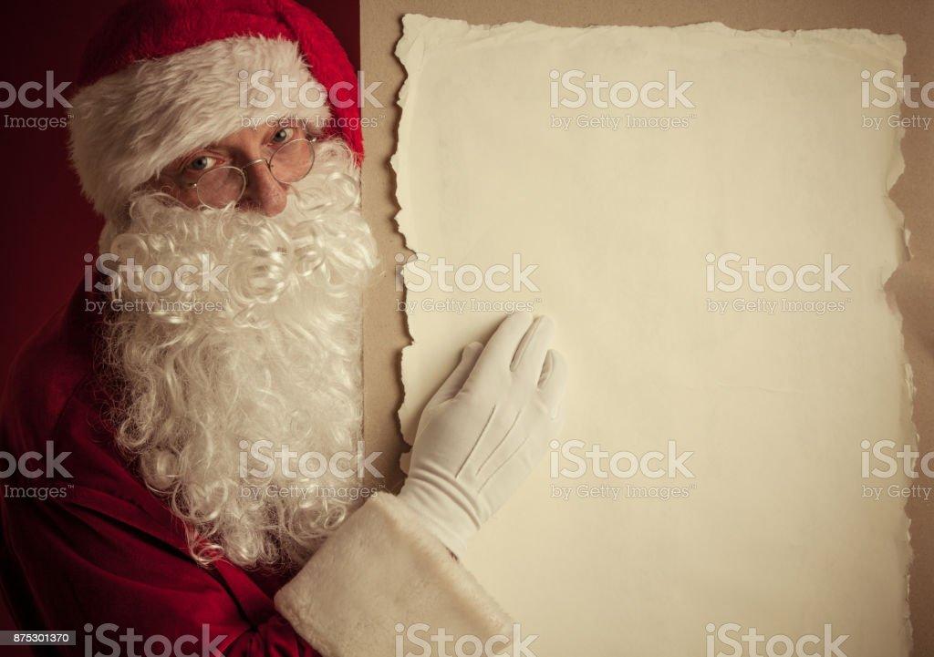 Santa Claus mit Vintage-Papier – Foto
