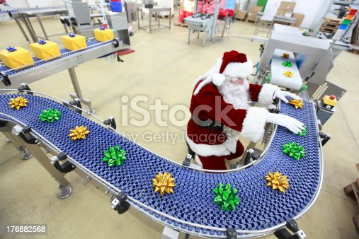 santa claus as a quality control manager at christmas ornament production line in factoryMore about Santa Claus  Cristmas preparation :