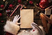 istock Santa Claus writting letter on wooden table 881103218