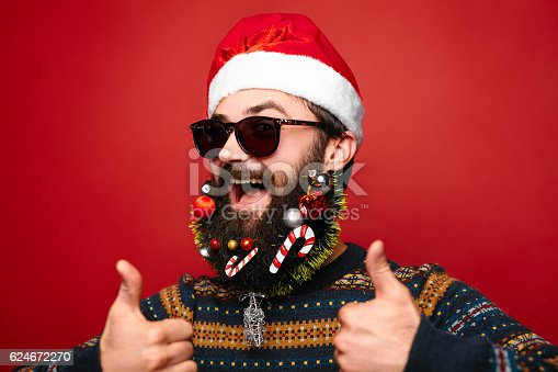 istock Santa Clause horizontal. Happy New Year. Marry Christmas. Decorated beard 624672270
