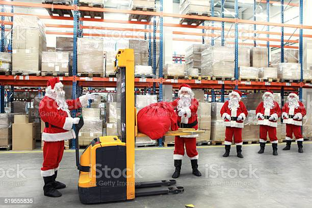 Santa Clauses In Line For The Sacks Of Gifts Stock Photo - Download Image Now