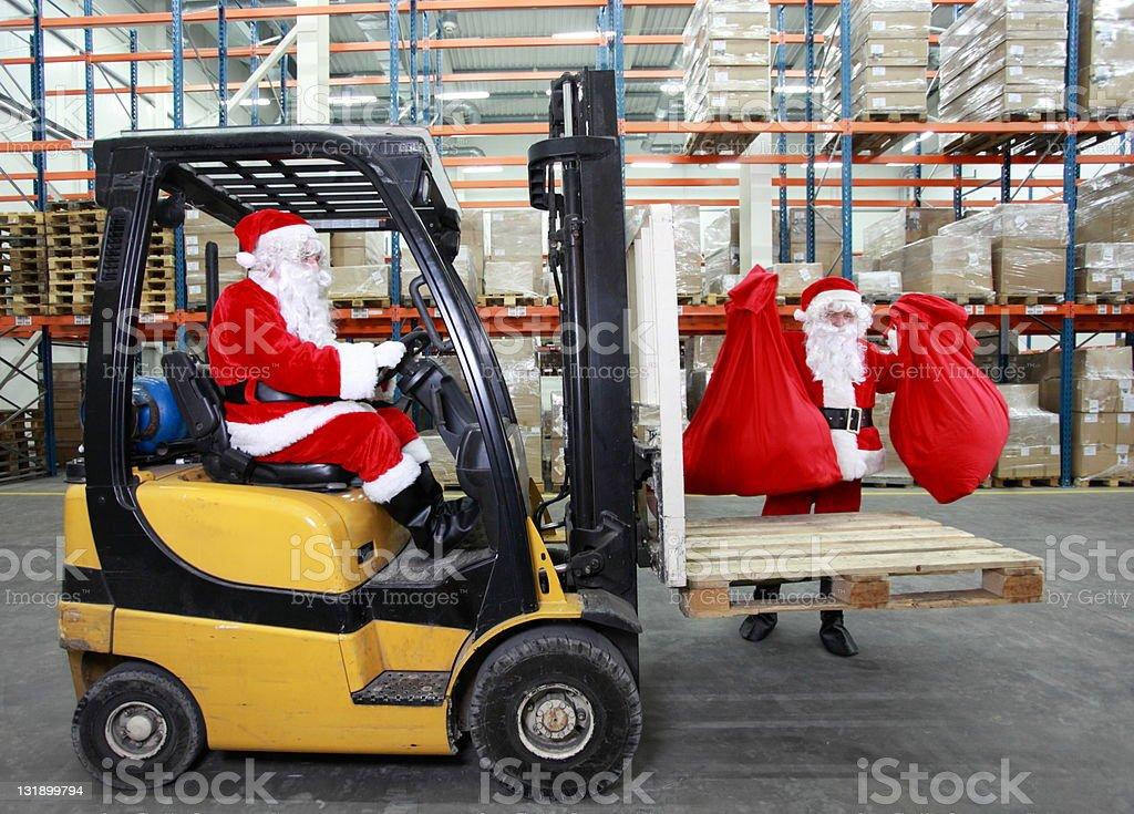 Santa clauses preparing for Christmas stock photo