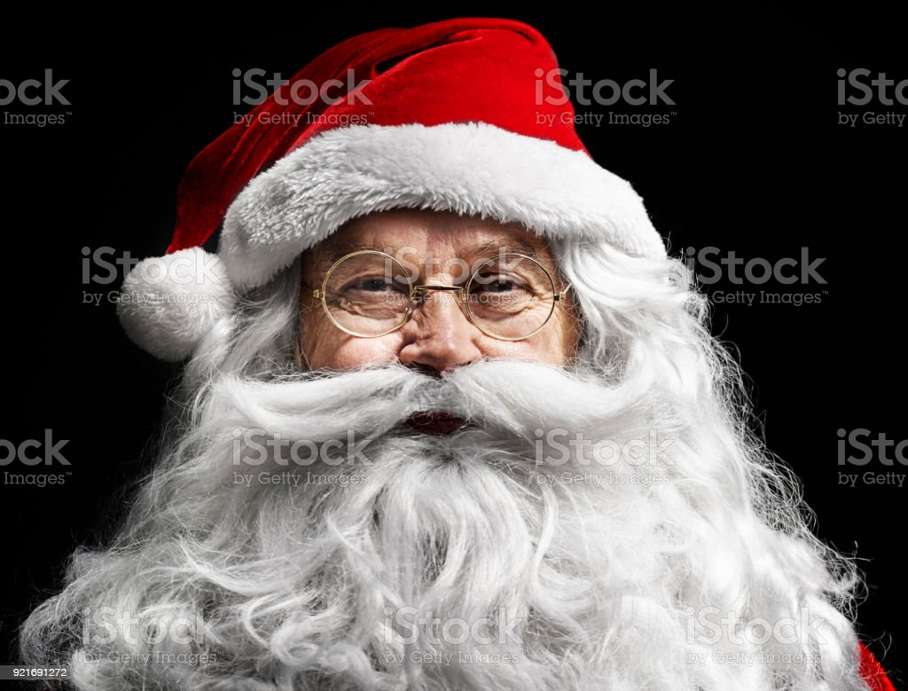 Santa claus's human face on  black background stock photo