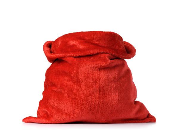 santa claus de rode zak, vol, op witte achtergrond. bestand bevat uitknippad - zak tas stockfoto's en -beelden