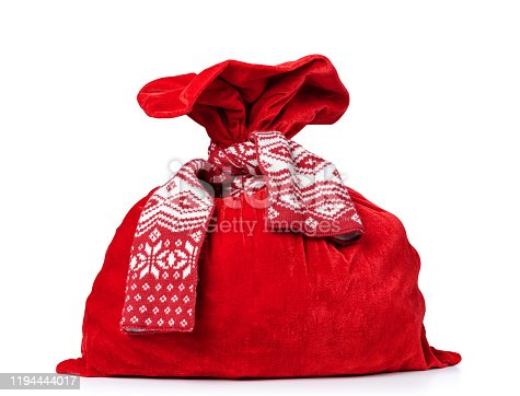 istock Santa Claus's red bag full with gift, tied scarf, isolated on white background. File contains a path to isolation. 1194444017