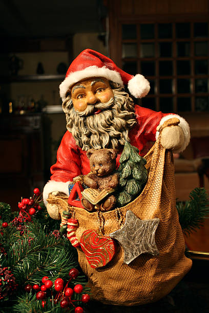Santa Clauss with the bag of gifts stock photo