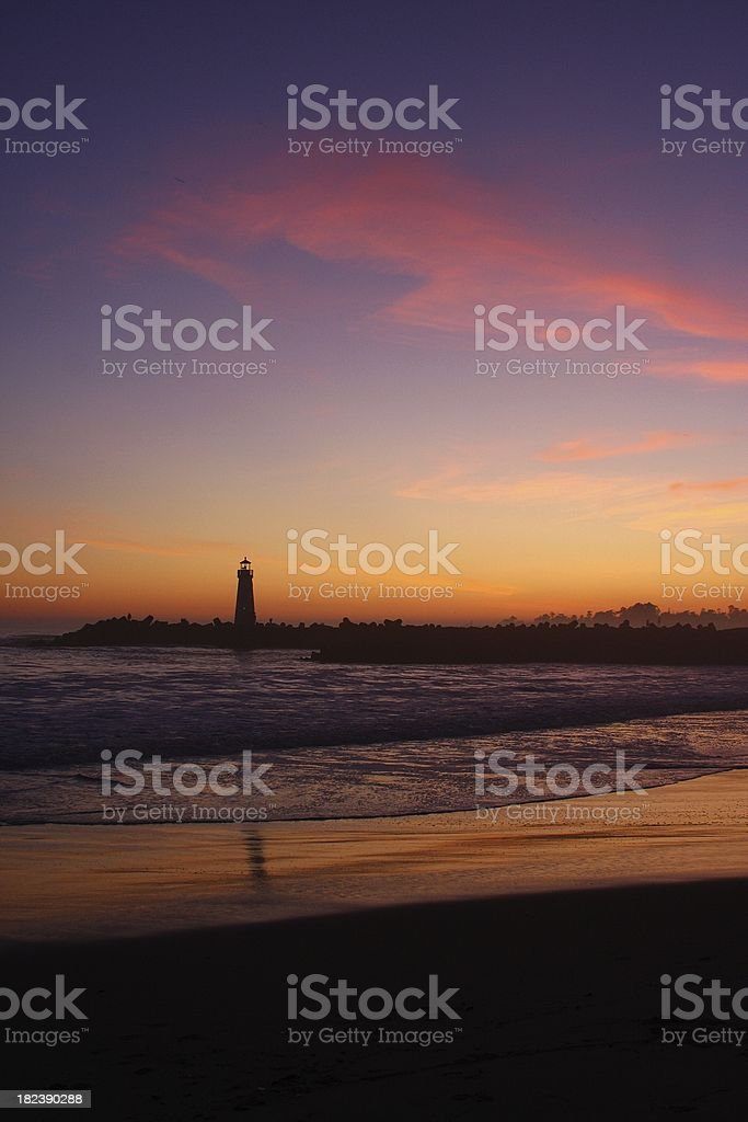 Santa Cruz California Pacific ocean beach Lighthouse at sunset stock photo