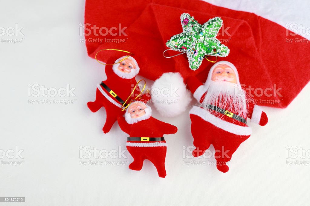 Santa dolls and cap on a white background stock photo