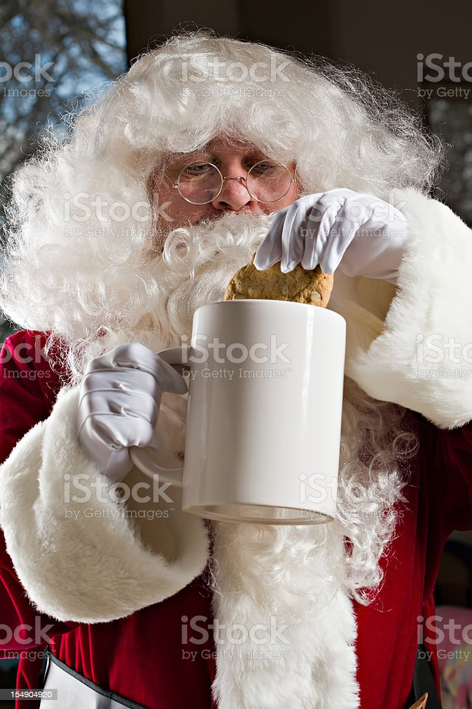 Santa Dunks His Cookie royalty-free stock photo