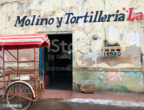 Santa Elena, Yucatan, Mexico: A pedicab in front of a sunlit tortilla bakery in Santa Elena, a Mayan village 10 kilometers from the Mayan Uxmal ruins in the Yucatan Peninsula, Mexico.