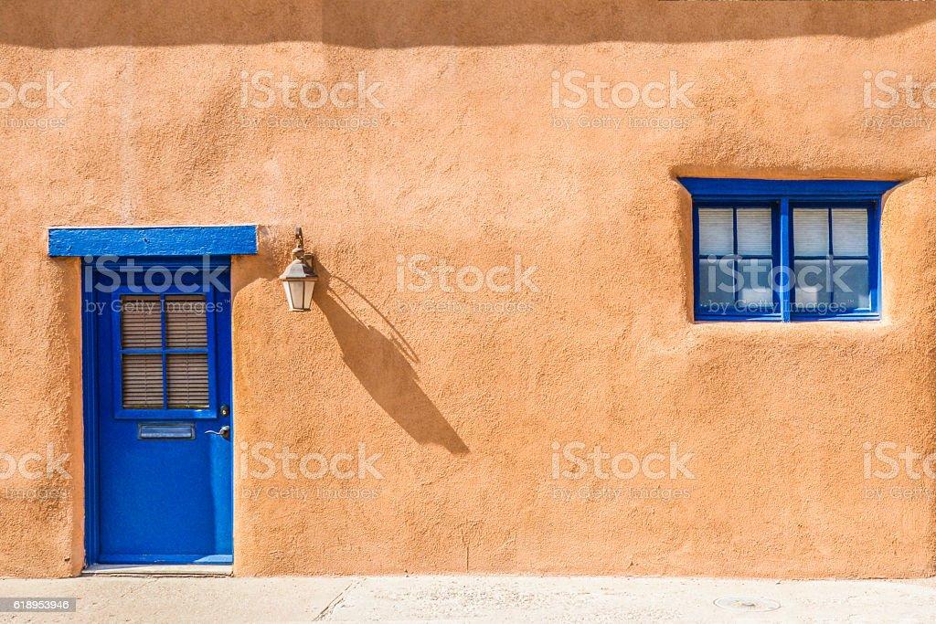 Santa Fe Blue Door And Window On Stucco Wall Stock Photo