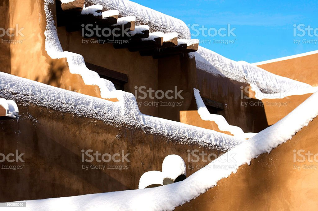 Santa Fe in Snow: Intersecting Adobe Walls Piled with Snow stock photo