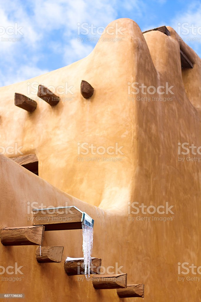 Santa Fe in Winter: Intersecting Adobe Walls Piled with Snow stock photo