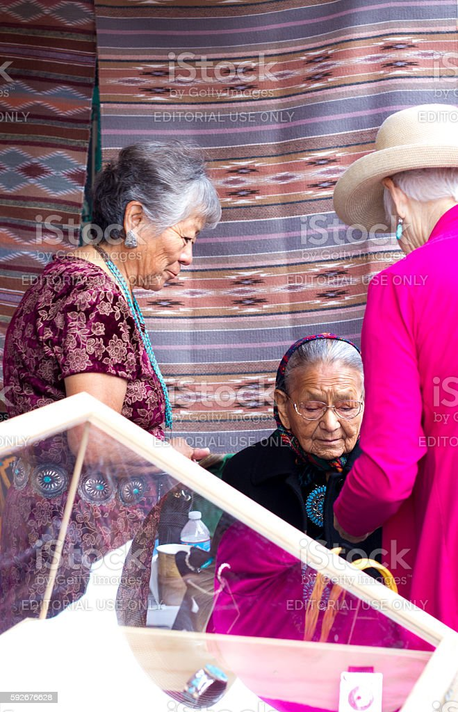 2016 Santa Fe Indian Market: Navajo Weavers with Rugs stock photo