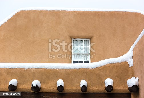 Santa Fe, NM: Adobe Walls in a snowstorm. Copy space available.