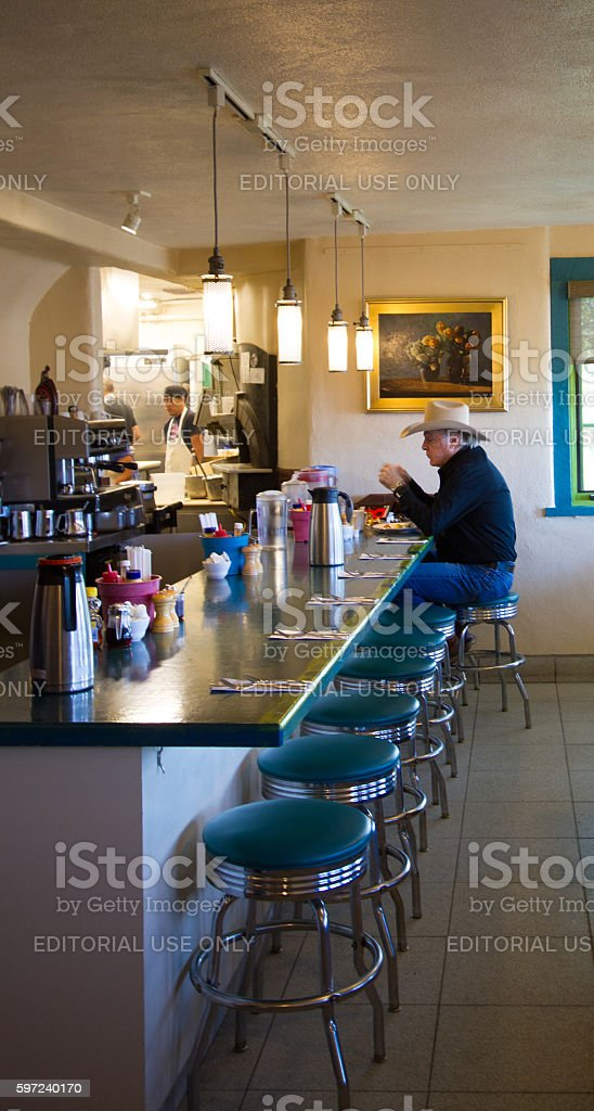 Santa Fe NM: Cowboy Eats Alone at Old-Fashioned Lunch Counter stock photo