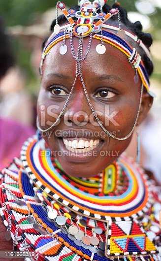 Santa Fe, NM: A beautiful Kenyan artist in elegant beaded clothing at the Folk Art parade on the historic Santa Fe Plaza. The free parade kicks off the annual International Folk Art Market (IFAM), where artists from over 100 countries participate.